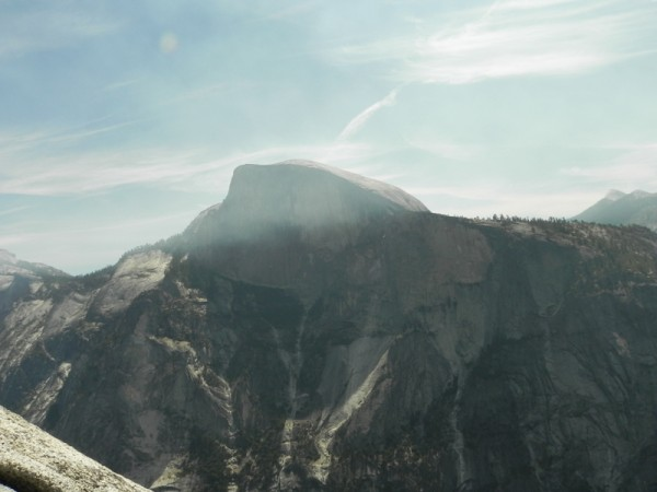 Half dome wreathed in smoke from fires.