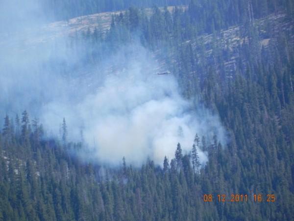 Heli dumps water on fire.