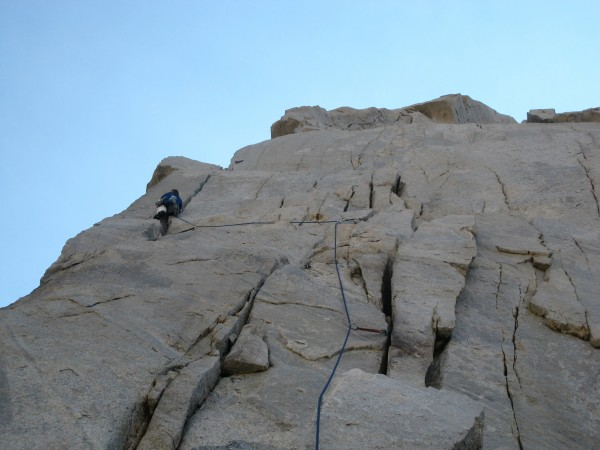 Climbing toward a remarkable ledge at the end of pitch five