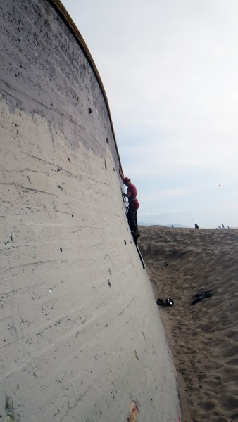 Aid bouldering at the beach. The sand could make for a nice landing.