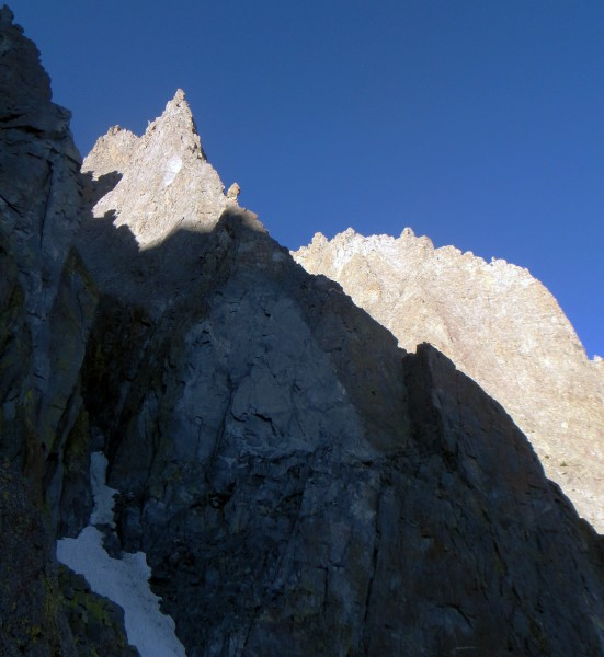 Sun Ribbon Arete - The white mark, approach ledge & P1 in the corner. ...