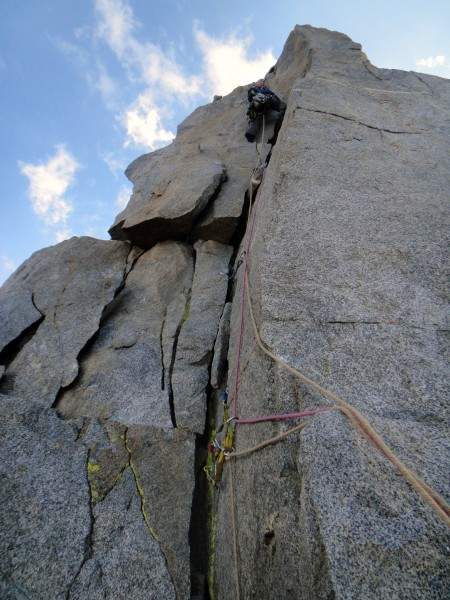 Chris leading the final 5.7 pitch. Watch for loose blocks that are tem...