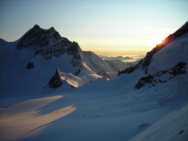 Jungfraujoch from the Mönch with the Junfrau on the left. The Jungfrau...