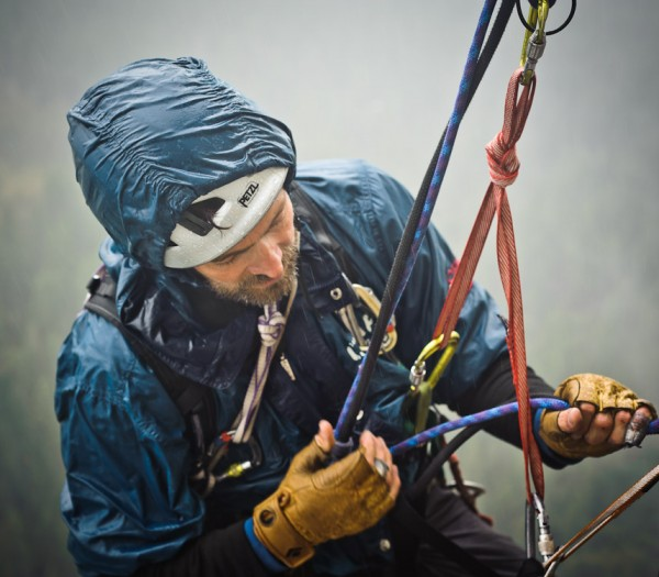 Stefan Jacobsen rappelling from the stovelegs in stormy weather on Mon...