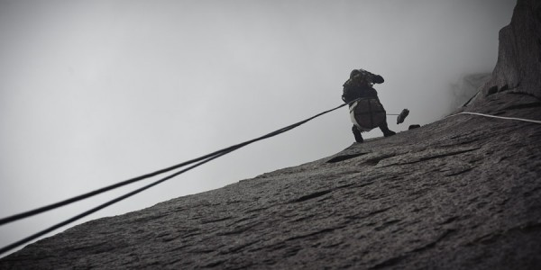 Rappelling with haulbag and poop tube from the Stovelegs in stormy wea...